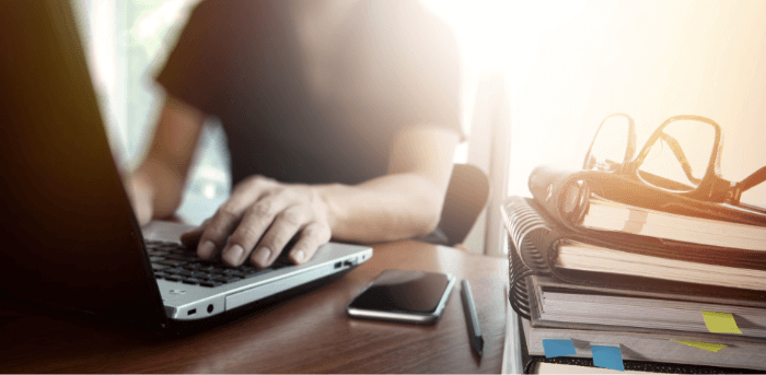 young man typing at laptop computero computer